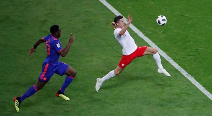 صورة من مباراة بولندا وكولمبيا