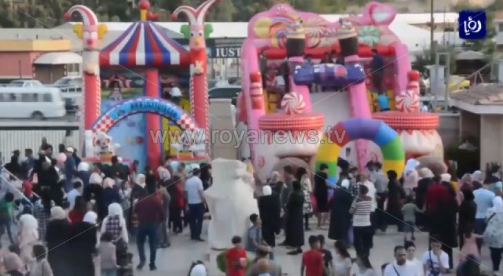 سكان العاصمة السورية دمشق يستعيدون فرحة العيد بعد سنوات الحرب
