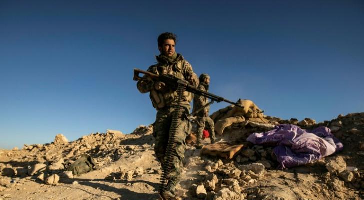 مقاتلون من قوات سوريا الديموقراطية في الباغوز في شرق سوريا