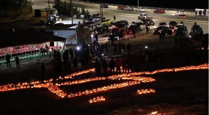 اضاءة 30 الف شمعة بالسلط نصرة للملك والقدس